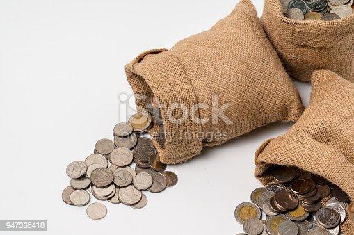 istock 3 sacks of money bags made from hemp sack fall on the floor 947365418