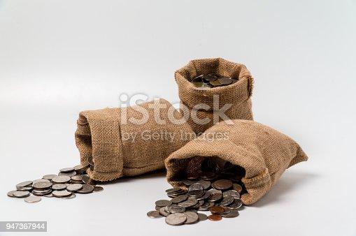 istock 3 sacks of money bags made from hemp sack fall on the floor 947367944