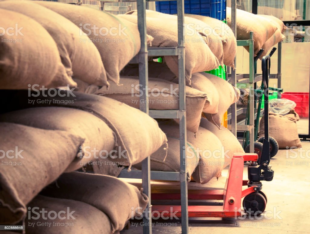 Sacks of rice and koffee in the warehouse. stock photo
