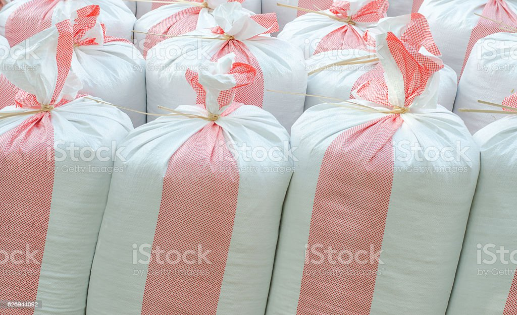 Sacks of rice, fertilizer farmer stock photo