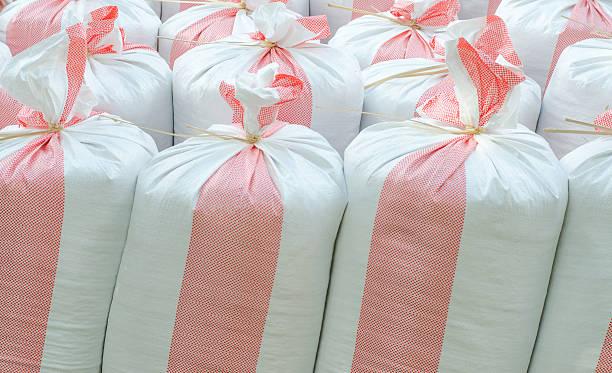 Sacks of rice, fertilizer farmer stock photo