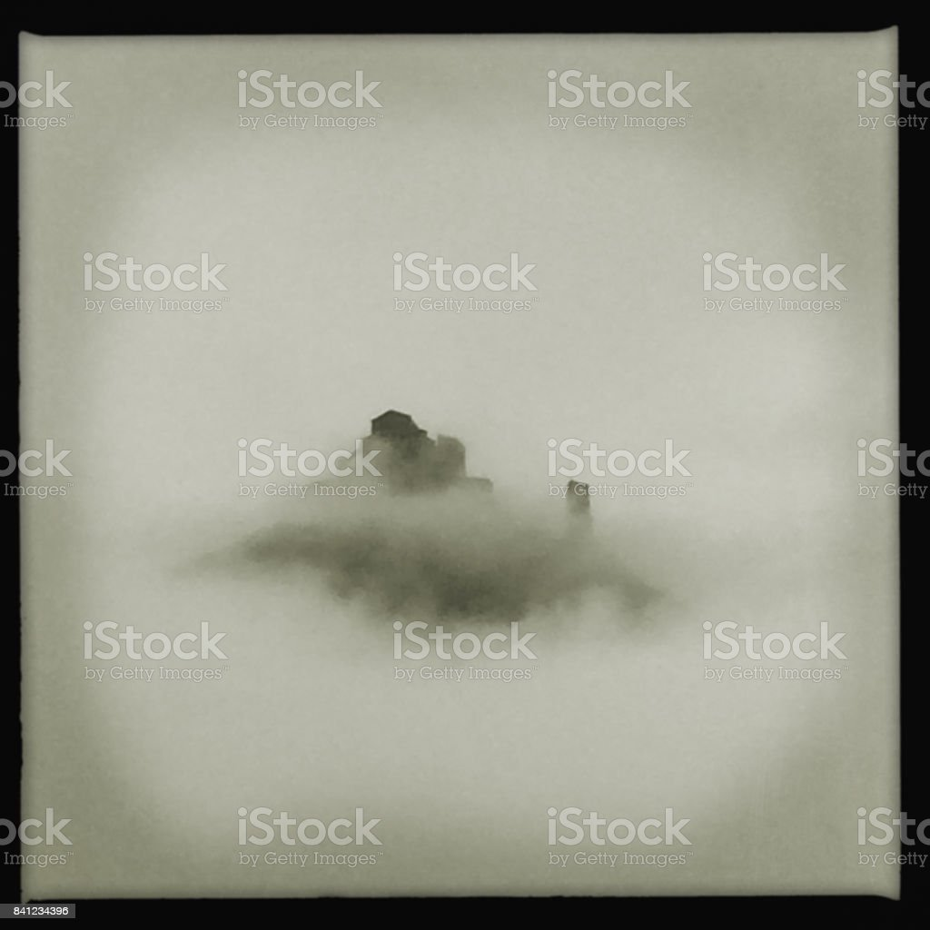 Sacra di San Michele in the fog stock photo