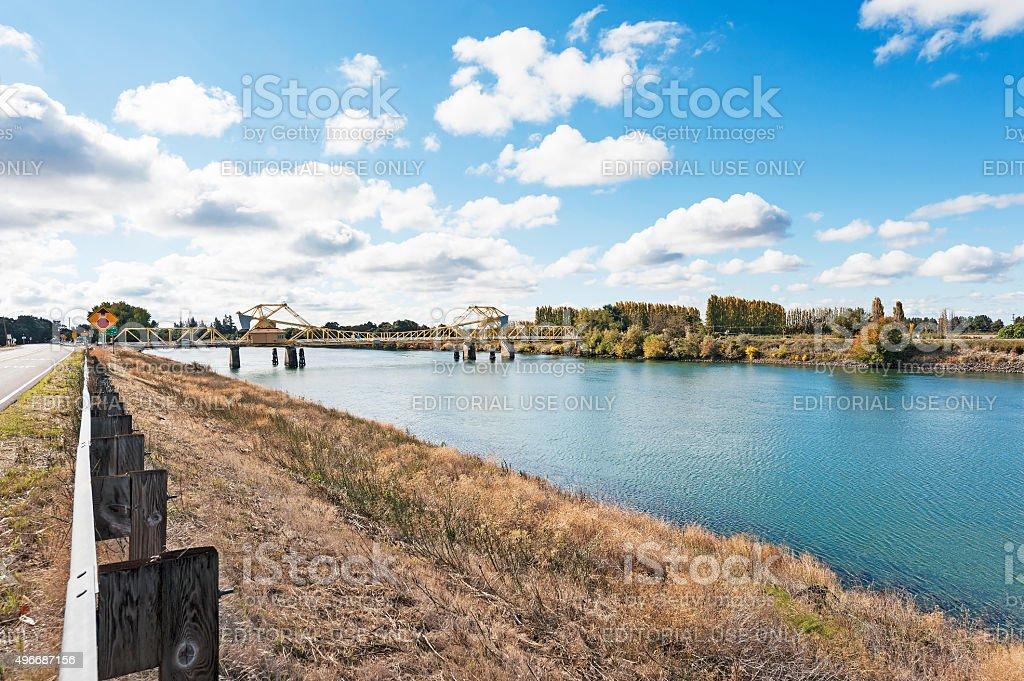 Sacramento Delta River Views with bridge and small town signs stock photo