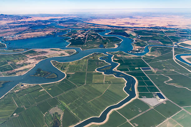 Sacramento River Delta Numerous waterways snake through the delta where the Sacramento River and San Joaquin River meet.  Visible in the photo is Bethel Island, Franks Tract State Recreation Area, Mandeville Tip County Park, and Brannan Island State Recreation Area. canal stock pictures, royalty-free photos & images