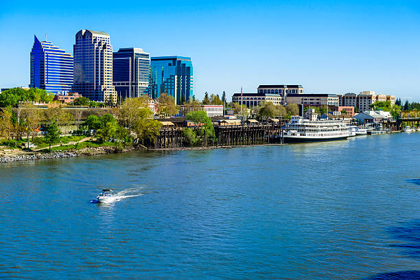 Sacramento River, riverfront and downtown skyline Sacramento skyline and riverfront on the Sacramento River. riverbank stock pictures, royalty-free photos & images