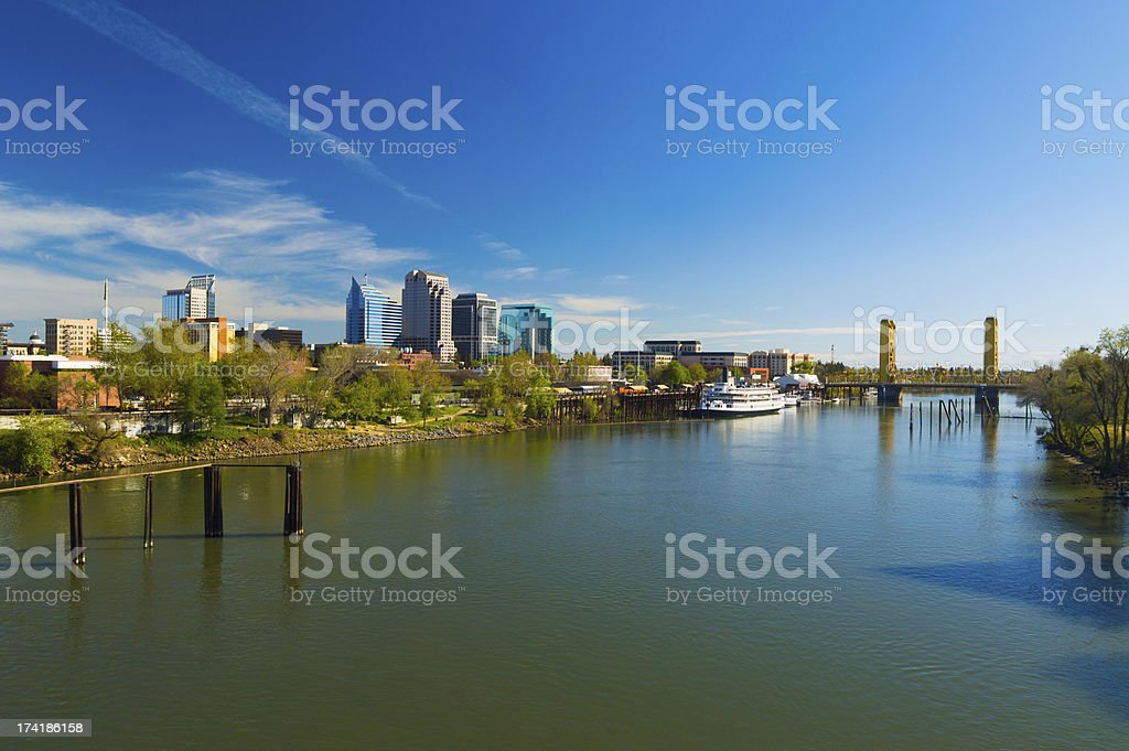 Sacramento skyline, riverboat, bridge, and river, wide angle view stock photo