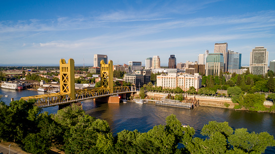 High quality stock aerial view photo of Sacramento's Tower Bridge and the Sacramento River, looking towards the Capitol mall and building.