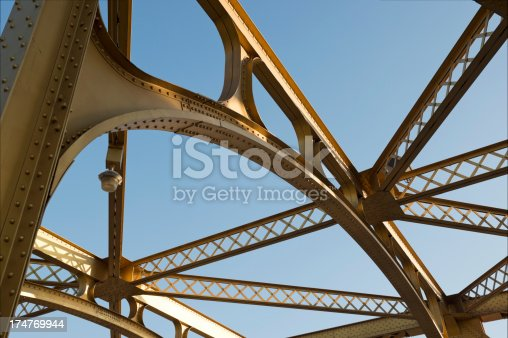 Looking up at part of the Sacramento Tower Bridge which is part of the National Register of Historic Places. The style is a streamline moderne vertical lift bridge across the Sacramento River.  Residents of the area voted on painting it gold. It is a yellow ochre color.