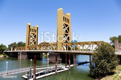 Sacramento Tower Bridge Daytime Blue Sky And River With Trees