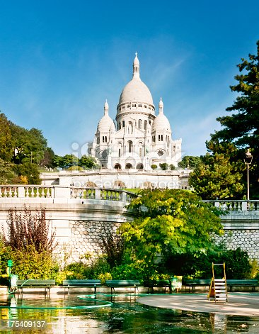 Sacre-Coeur de Montmartre in early morning light. Soft color effects with added grain.