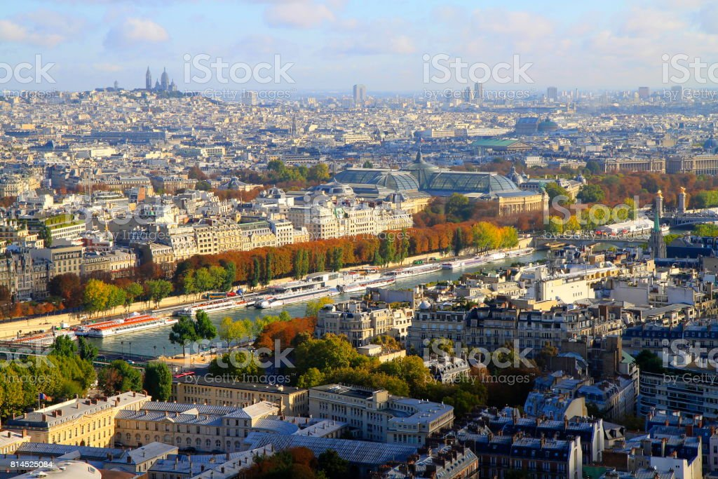 Sacre Coeur and Montmartre above Paris idyllic Urban Skyline roofs: majestic buildings at dramatic Sky sunrise from Eiffel Tower, Paris cityscape, France stock photo