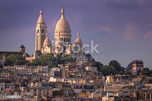 Sacre Coeur and Montmartre from above at gold colored sunset – Paris, France
