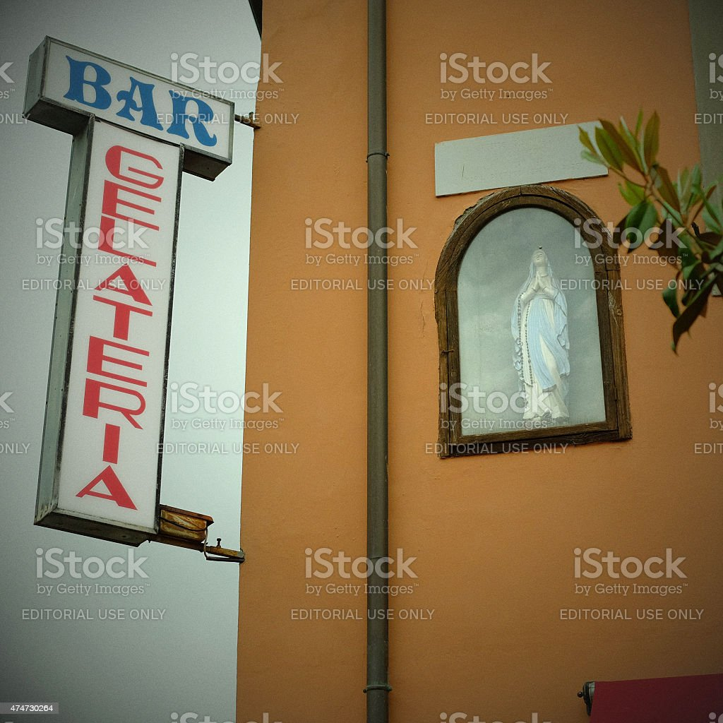 Sacred and profane in Italy - ice cream and Mary stock photo