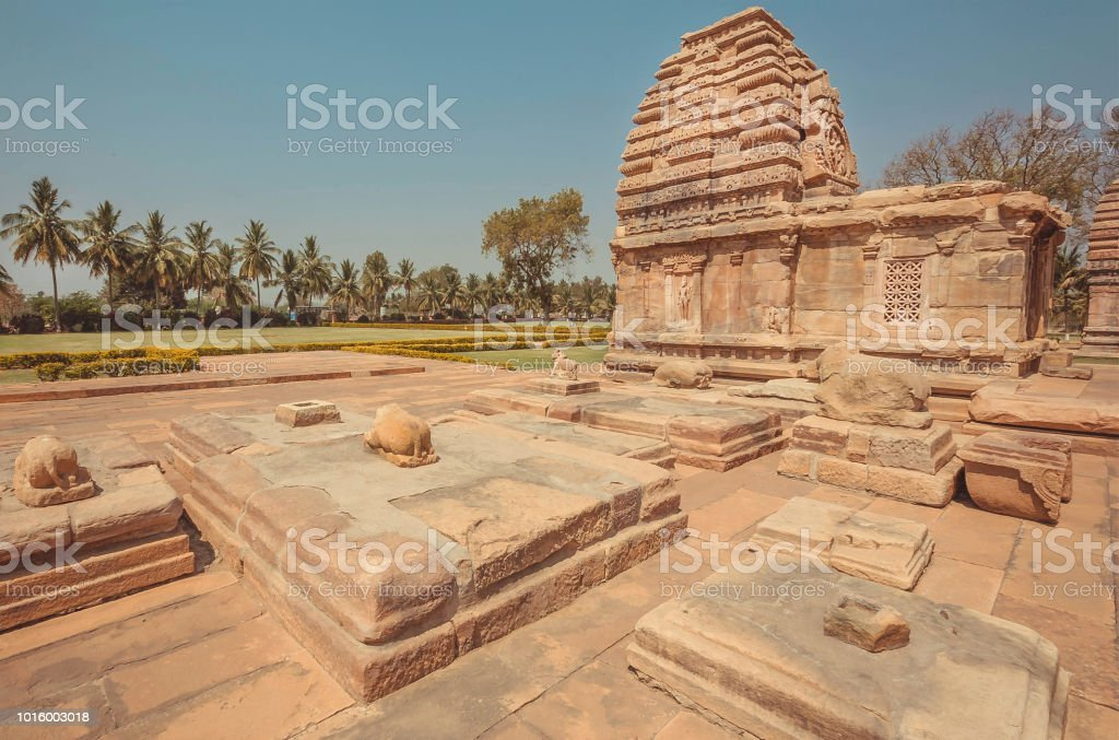 Sacred bulls statues and carved temples in tradition Hindu, Pattadakal. 7th century complex of India. UNESCO World Heritage site stock photo