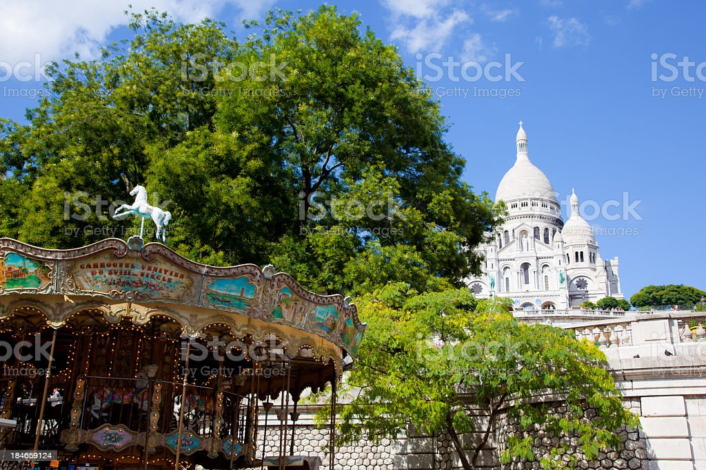 Sacred Heart Basilica of Montmartre and Carrousel, Paris royalty-free stock photo
