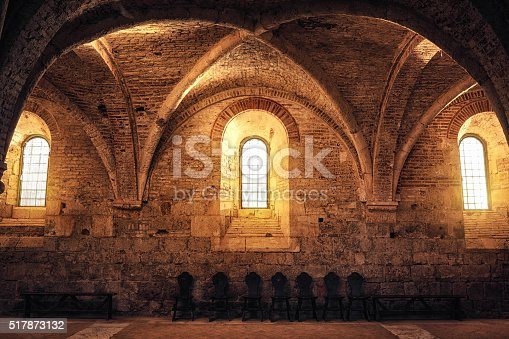 Illuminated sacred place in an old abbey (San Galgano, Tuscany).
