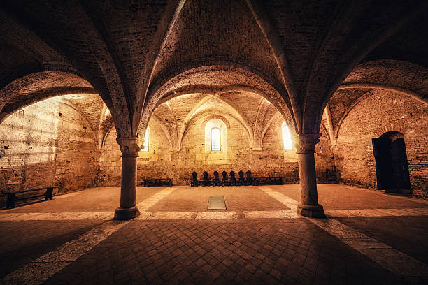 Sacred Place Illuminated sacred place in an old abbey (San Galgano, Tuscany). abbey monastery stock pictures, royalty-free photos & images