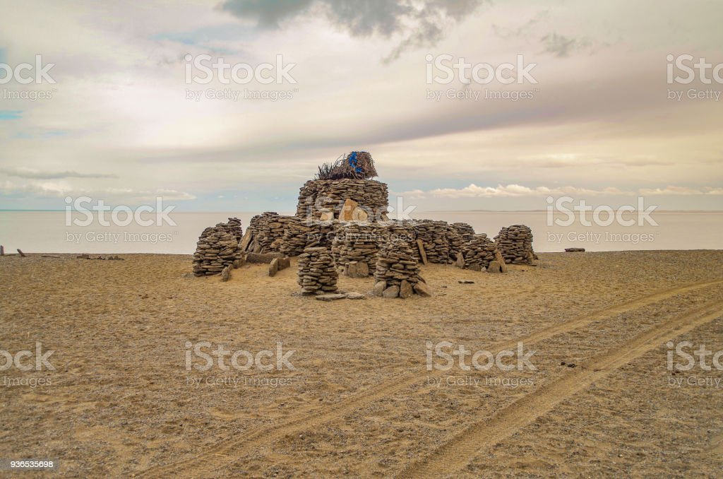 Sacred stone heaps (ovoo, oboo or obo). Altars or shrines in Mongolian folk religious practice. Sites for the worship. Ovoo at the southern shore of the saltwater Dorgon Lake. Nature and travel. Mongolia, Great Lakes Depression stock photo