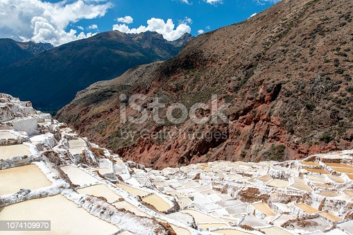 Sacred Valley Salt Mines in Maras, Peru, seen during a hot summer day.