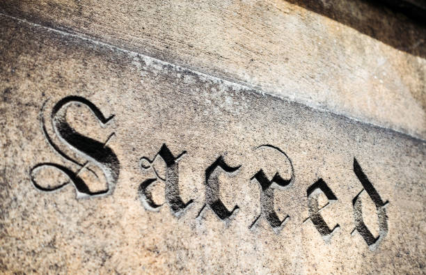 sacred word cut in stone - stone font stock photos and pictures