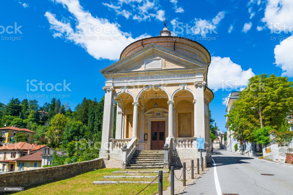 Sacro Monte of Varese (Santa Maria del Monte), Italy, starting point for the Via Sacra with 14 chapels that leads to medieval village. In the foreground the Immaculate church on a beautiful summer day stock photo