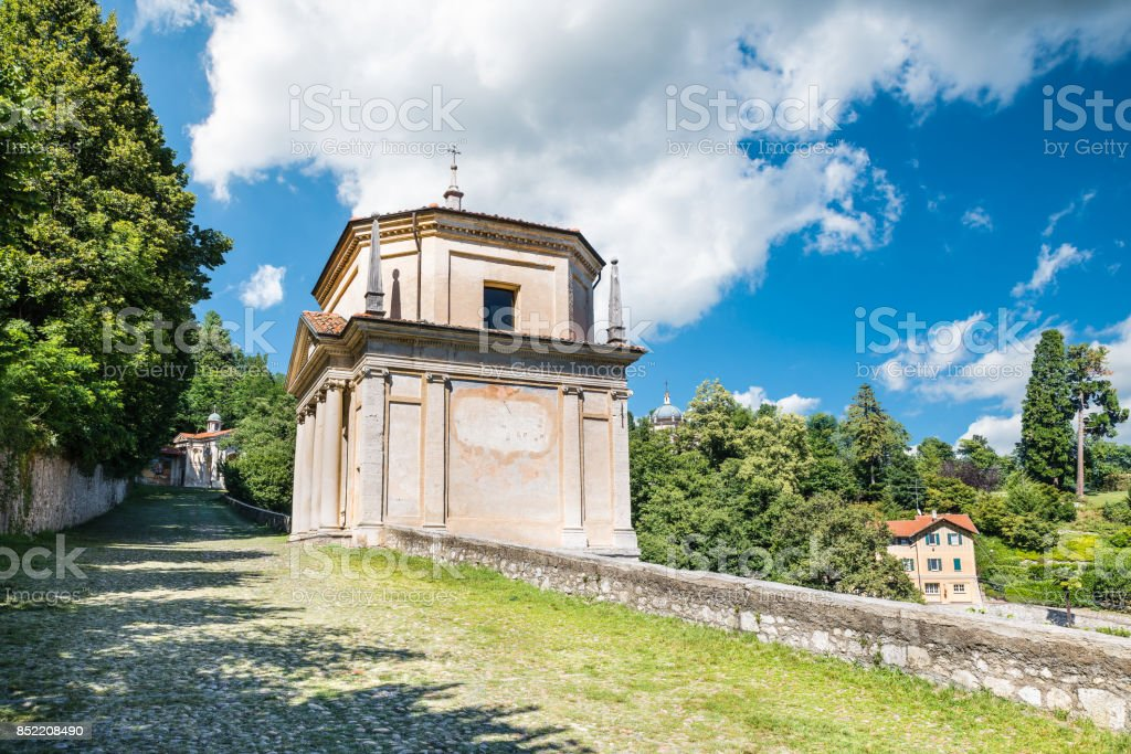 Sacro Monte of Varese (Santa Maria del Monte), Italy. Via Sacra that leads to medieval village, with the second chapel. In the background the third and the fourth chapel. World Heritage Site - Unesco stock photo