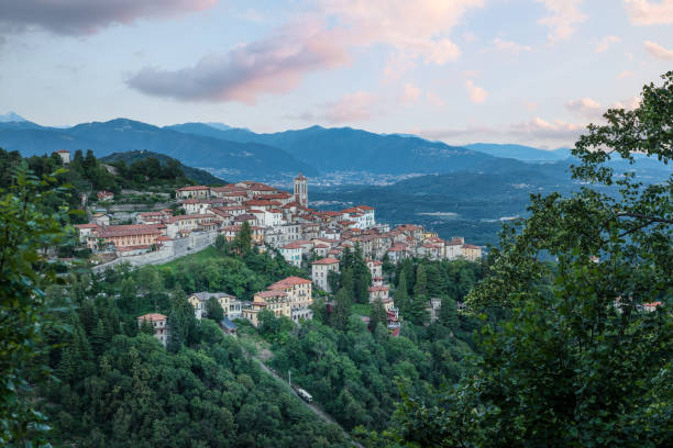 Sacro Monte of Varese (Santa Maria del Monte), Varese - Italy. Picturesque view of the small medieval village at sunset. Below the funicular is visible. World heritage site - UNESCO site stock photo