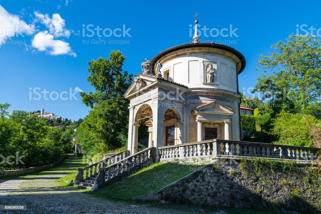 Sacro Monte of Varese (Santa Maria del Monte), Varese, Italy. Via Sacra that leads to medieval village, with the seventh chapel. In the background the village of Sacro Monte stock photo