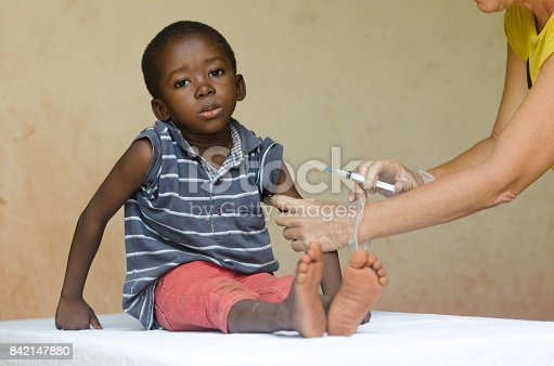 istock Sad African boy ready to get an injection from a volunteer nurse in Bamako, Mali 842147880