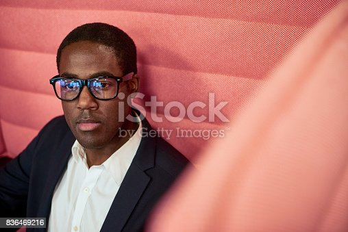 istock Sad African man in cafe 836469216