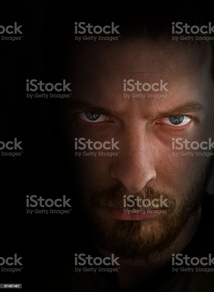 Sad and angry looking man stock photo