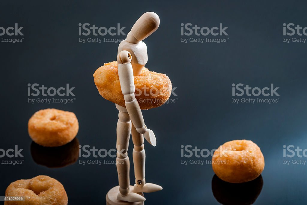 Sad and depressed overweight human figurine stock photo