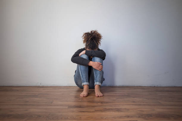 Sad and lonely black girl feeling alone Sad and lonely black girl feeling depressed unbalanced stock pictures, royalty-free photos & images