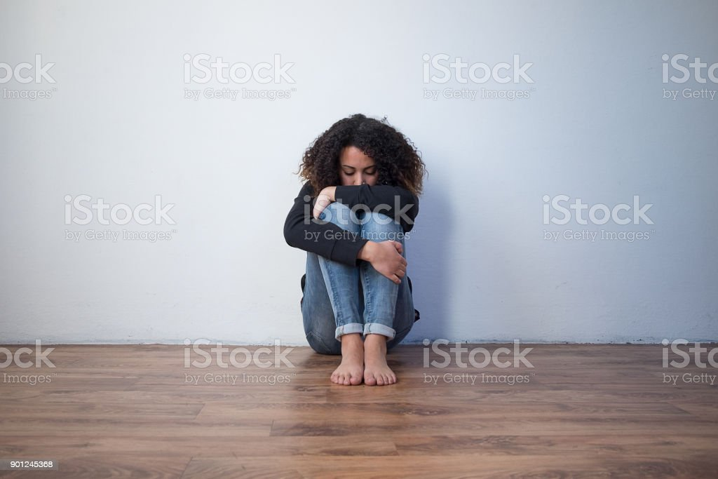 Sad and lonely black girl feeling alone royalty-free stock photo