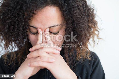 istock Sad and lonely black girl feeling sick 656287096