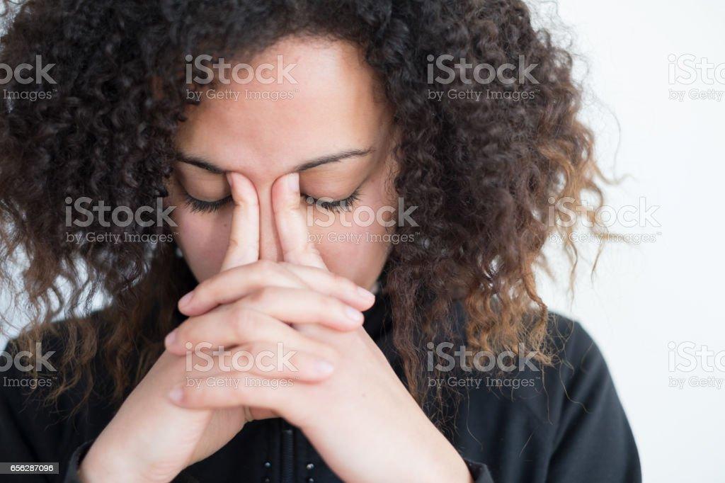 Sad and lonely black girl feeling sick stock photo