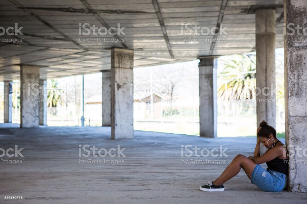 Sad and lonely black teenager in the city stock photo