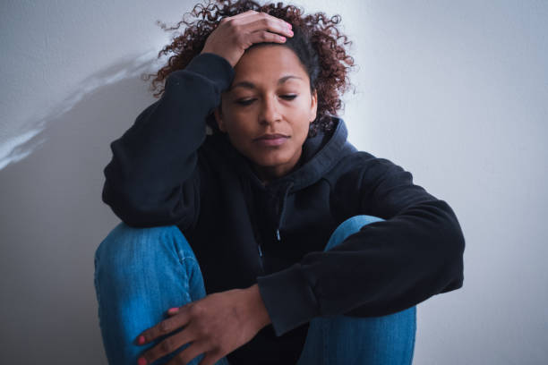 Sad and lonely girl feeling abandoned needs help Black girl feeling unwanted abandoned and unloved drug rehab stock pictures, royalty-free photos & images