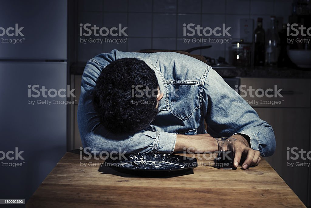 Sad and lonely man drinking after dinner royalty-free stock photo