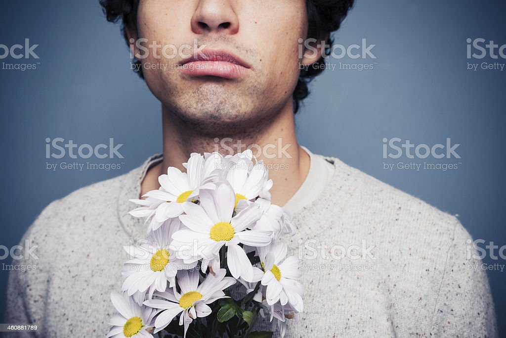 Sad and rejected man with a bouquet of flowers stock photo