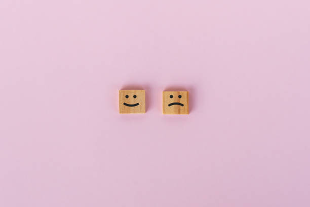 sad and smiling symbol on wooden block - icon set healthy foto e immagini stock
