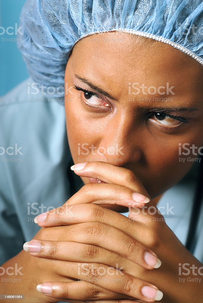 Sad and unhappy nurse stock photo