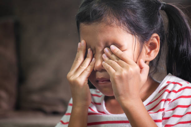 Sad asian child girl is crying and rubbing her eyes with her hands Sad asian child girl is crying and rubbing her eyes with her hands poor asian little girl crying stock pictures, royalty-free photos & images