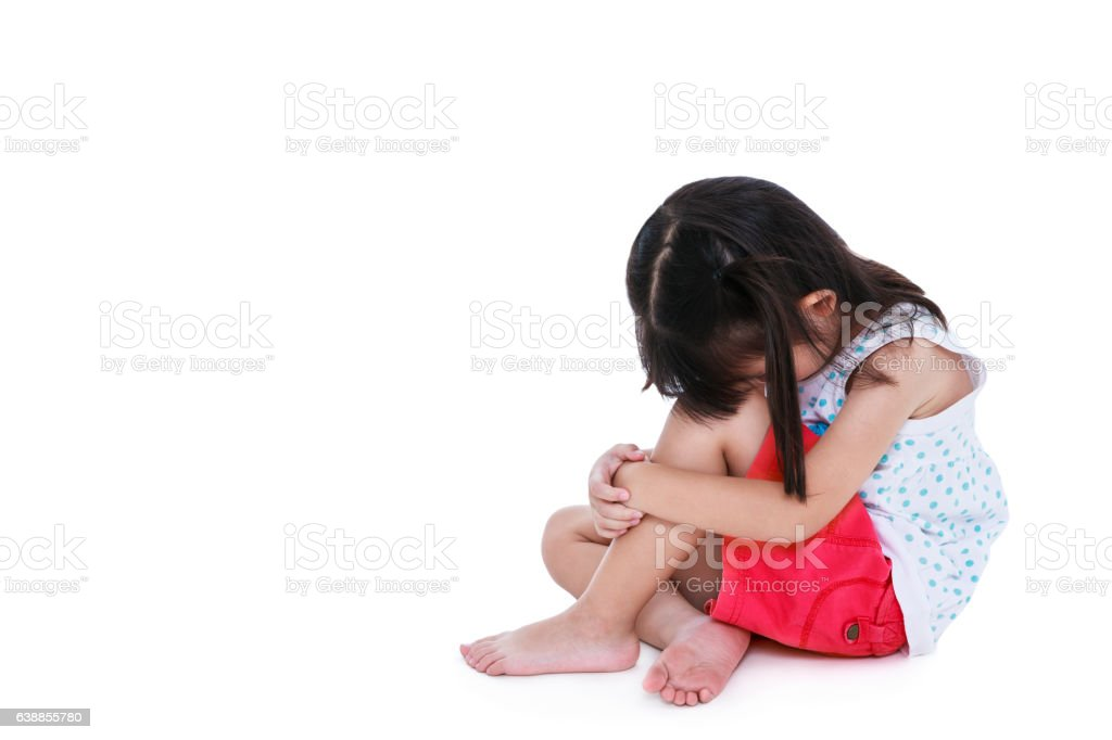 Sad asian girl barefoot sitting on floor with copy space. stock photo