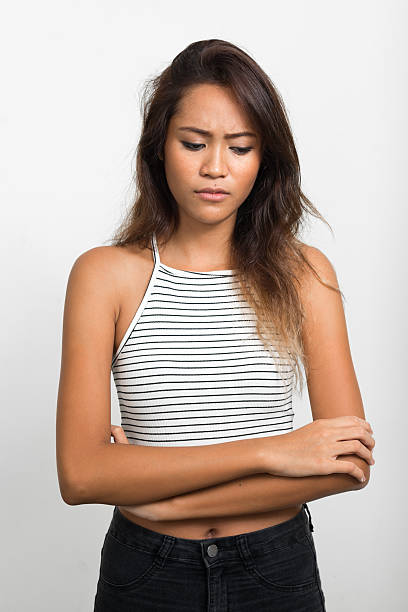 sad asian woman - 20 29 years stock photos and pictures