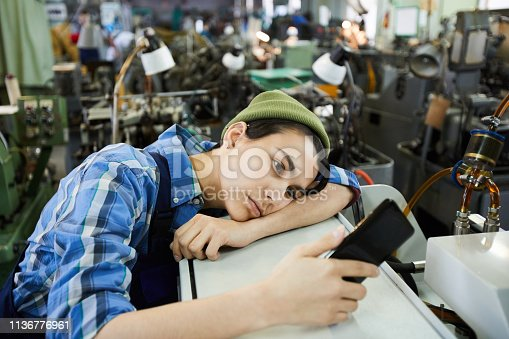 Young woman worker being bored at workplace