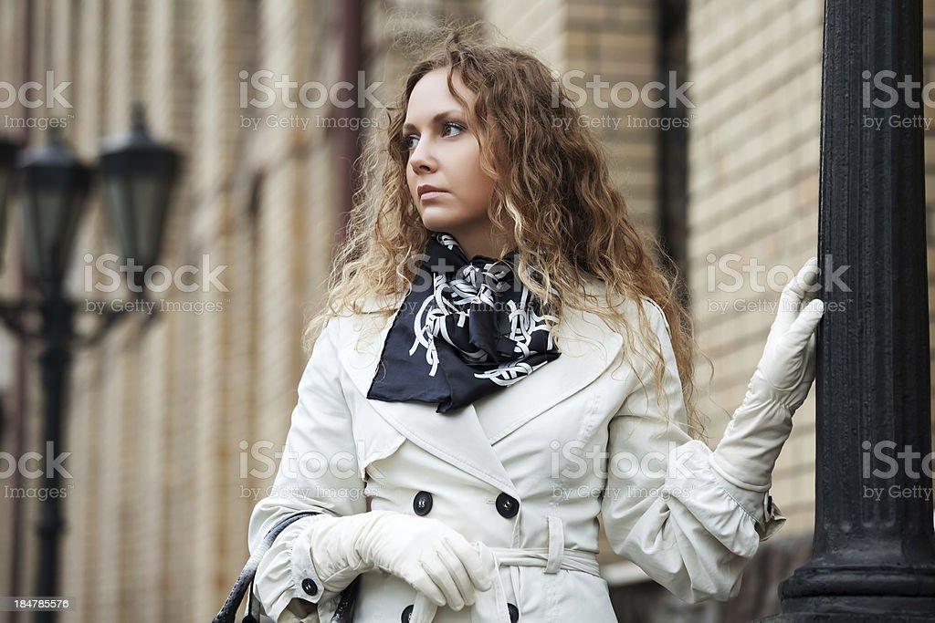 Sad beautiful woman at lamppost royalty-free stock photo