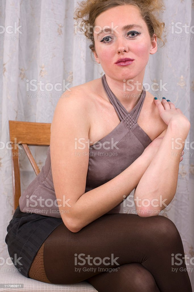 Sad beauty: sitting on the chair stock photo