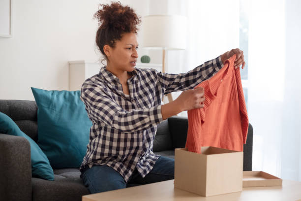 Sad black woman disappointed by bad product purchase stock photo