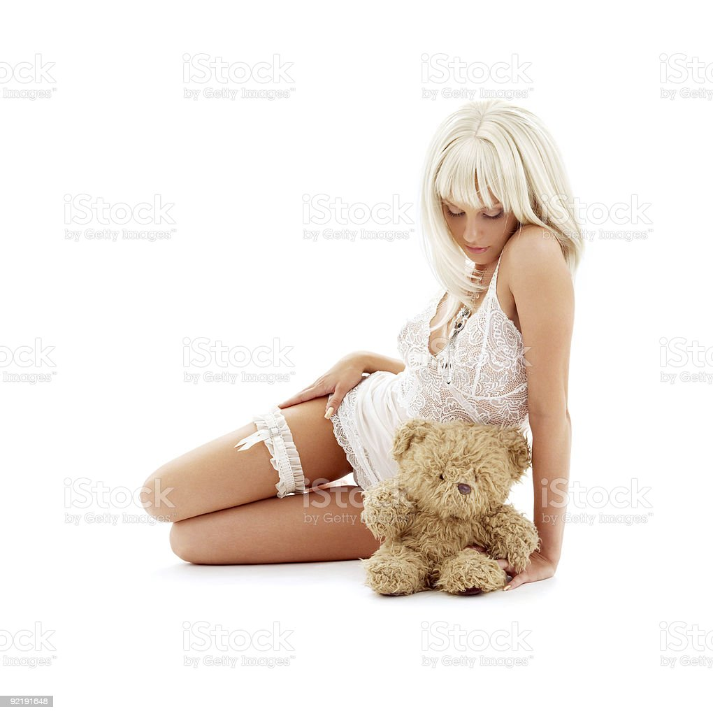 sad blond with teddy bear stock photo